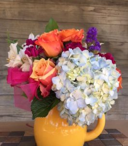 blue-hydrangeas-and-orange-roses